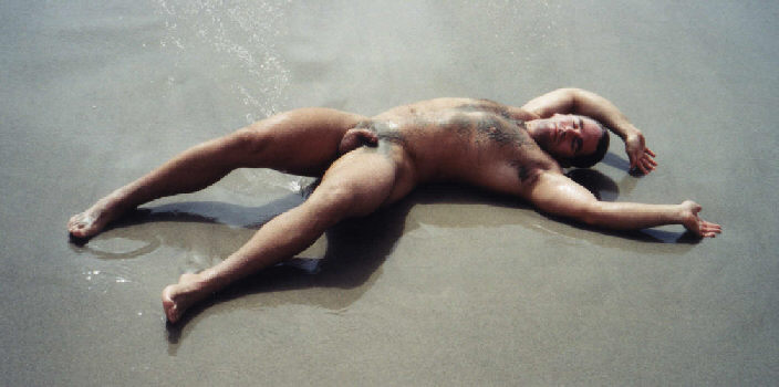 Muscular Stud John X Lying Naked On The Beach!